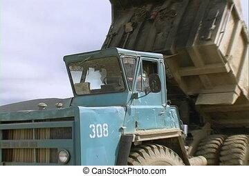 Dump trucks. - Dump truck in a quarry.