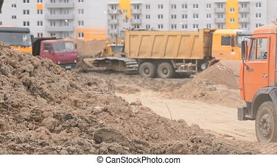 Dump trucks working on a construction site