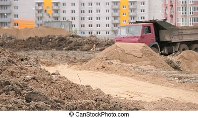 Dump trucks working on a construction site