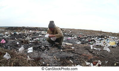 dump unemployed homeless dirty looking food waste in man a landfill social video