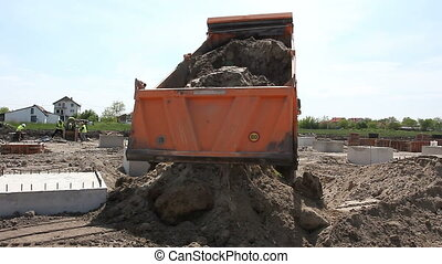 Dumper truck is unload soil