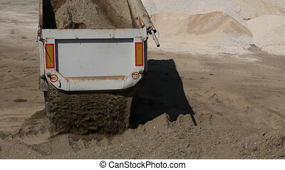 Dumper truck is unload soil - Dumper truck is unloading sand...
