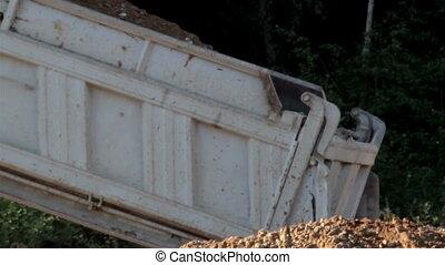 Dumping of soil using the dump truck and truckload of Gravel...