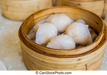 Dumpling in Bamboo Basket. - Steamed prawn dumplings (dim...