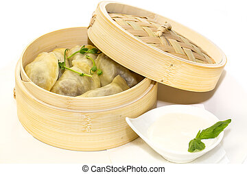 dumplings and sour cream - dumplings with sour cream in a ...