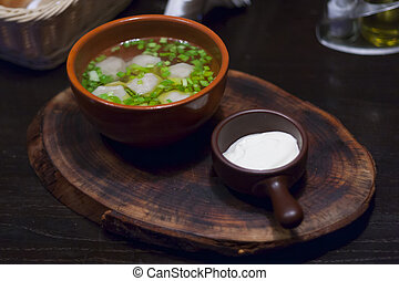 dumplings in a pot with sour cream