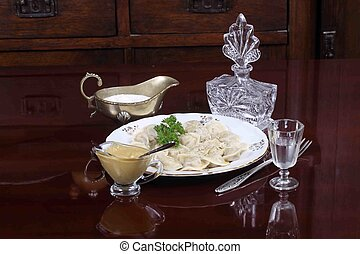 dumplings served with sour cream, mustard and vodka