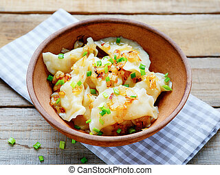 dumplings with potatoes in a bowl