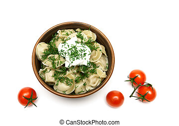 dumplings with sour cream and cherry tomatoes isolated on a white background