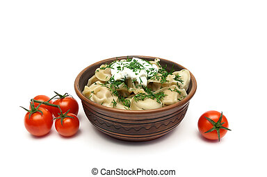 dumplings with sour cream and cherry tomatoes on a white background