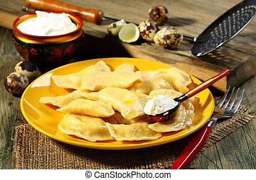 Dumplings with sour cream.