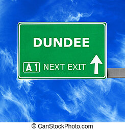 DUNDEE road sign against clear blue sky