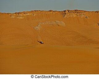Dune Buggy Races Across Desert