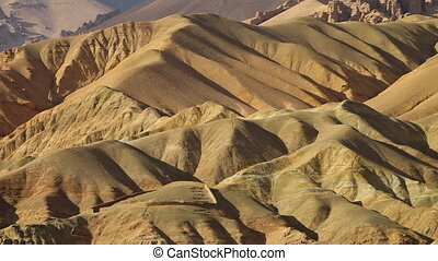 Dunes of sand and hills of argil - A steady, aerial, wide...