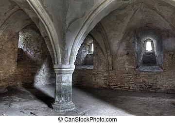 Ancient dungeon dark stone basement with gray sand floor