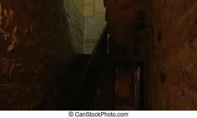 Dungeon with a lamp - A medium shot of a dungeon with a...