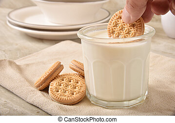 Dunking a cookie in milk