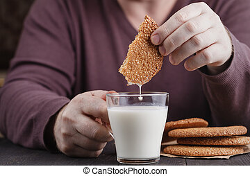 Dunking cookies in glass of milk