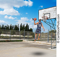 dunking in a basketball playground
