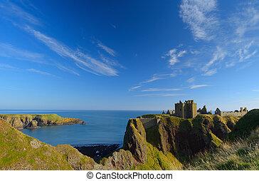 Dunnottar Castle with blue sky background in Abeedeen, Scotland.