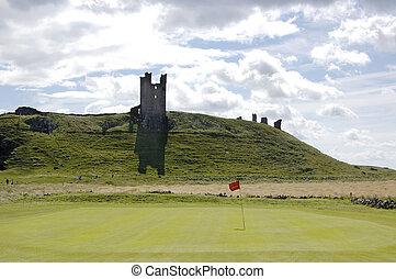 Dunstanburgh Castle and Golf green - One of the greens of...