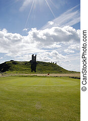 Dunstanburgh Castle and Golf green vertical - One of the...