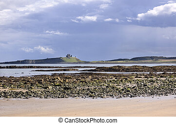 Dunstanburgh castle from beach