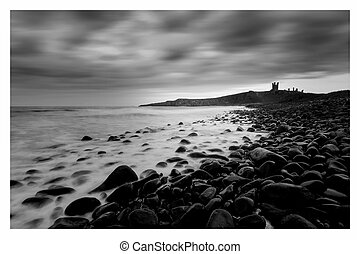 Dunstanburgh Castle on the coast of Northumberland in...