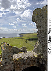 Dunstanburgh Castle wall and coastline - The crumbling walls...