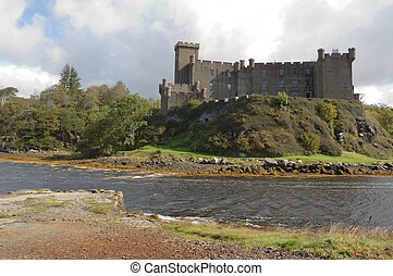 Dunvegan Castle and harbour on the Island of Skye, Scotland...