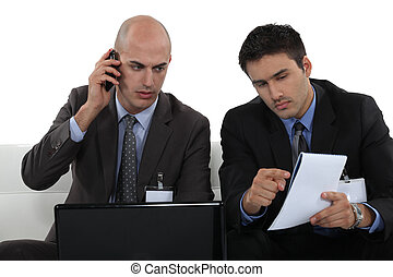 duo of businessmen working together