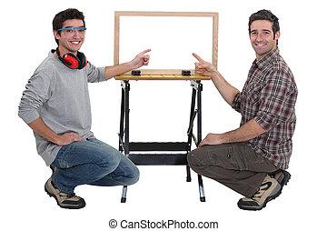duo of carpenters all smiles