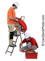 duo of tradesmen at work