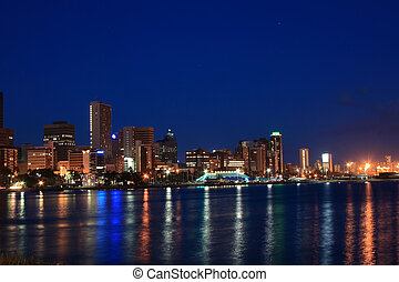 Durban night scene - the lights reflecting on the harbour at...