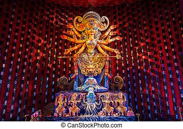 Durga idol - Colorful idol of Goddess Durga being worshipped...