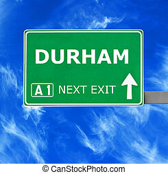 DURHAM road sign against clear blue sky