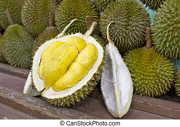 Durian 2 - Durian open in display with yellow flesh on fruit...