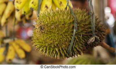 Durian fruit in the market - fresh durian at street market...