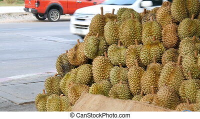 Durian is on the counter of street store. Exotic fruits of...