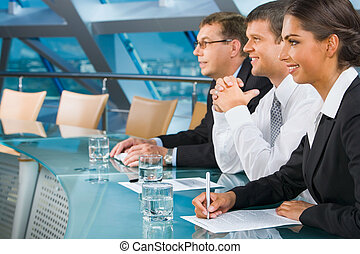 During a conference - Business people are listening to the...