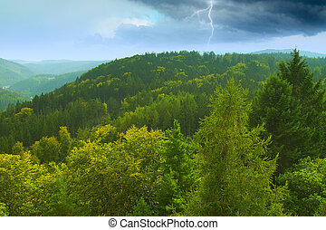 during a storm in the mountains lightning.