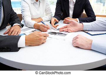 During explanation - Image of business people hands working ...