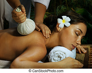 during massage - portrait of young beautiful woman in spa...
