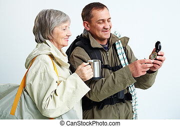 During trip - Portrait of happy senior couple looking at...