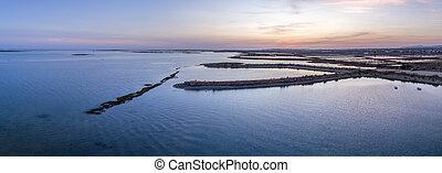 Dusk aerial panoramic seascape view of Olhao salt marsh...