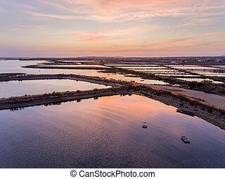 Dusk aerial seascape view of Olhao salt marsh Inlet,...