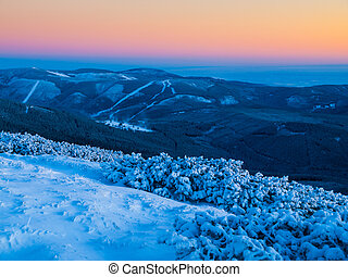 Dusk in winter mountains