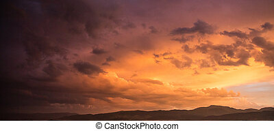 Red cloudy sky at sunset, mountain range, banner, copy space, wallpaper.