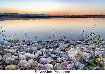Dusk over a lake in Colorado foothills