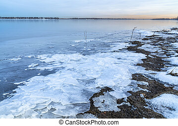 dusk over frozen lake in northern Colorado